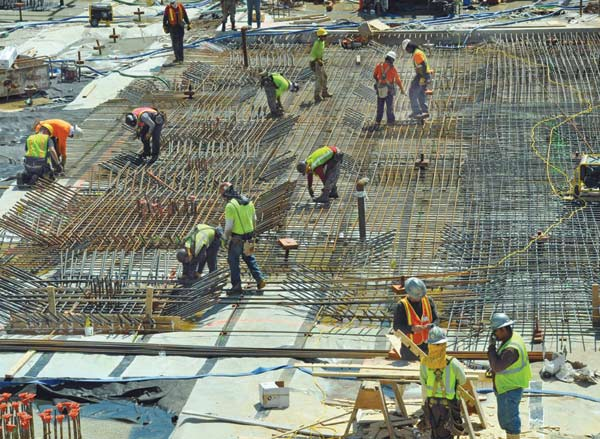 Contractors boost wages in boom